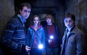 Harry with Hermione, Ron and Neville - from Arts Mic - image source: AP