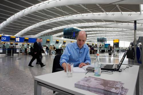 Alain de Botton writing in the new Terminal 5 at Heathrow Airport. Image source: Zocalo Public Square