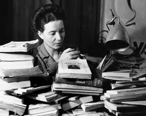 Simone de Beauvoir. The only fashion statement you really need … piles of books! Image source: BooksTellYouWhy