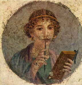 A Roman woman writer, Terentia or Terenzia. She wears the gold hairnet common to the Imperial Period in Pompeii. Image source: Wikimedia Commons