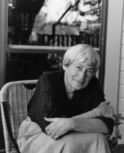 Ursula K Le Guin. Le Guin sticks to very traditional colours, grey, black, and white. Image source: Photo by Marian Wood Kolisch, from UKLG's official website