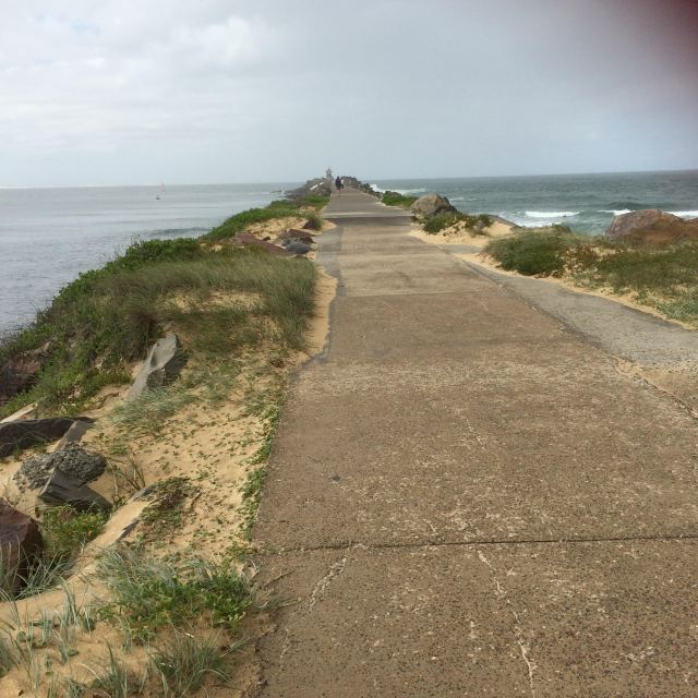 The long road to Fort Scratchley lighthouse at Nobby's Beach, Newcastle. Image source: My camera.