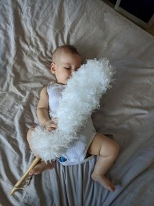 Baby Zoe playing with feather duster 1