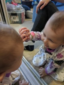 Baby Zoe playing with mirror