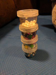 DIY Baby sensory toy rattle shaker pearls and confetti in empty formula containers